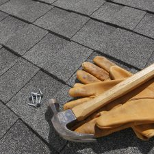Shingle Roof with Gloves and Hammer