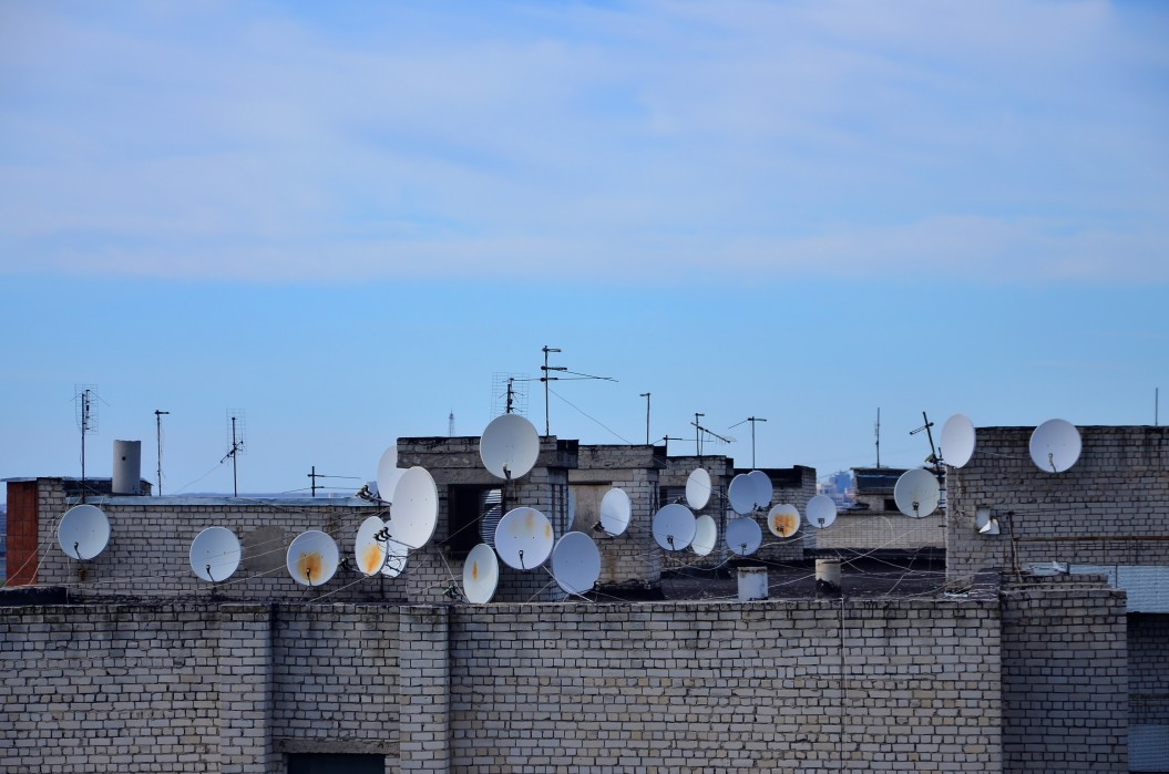 a-lot-of-satellite-and-antennas-roof-hole